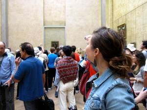 trying to catch of glimpse of the Mona Lisa